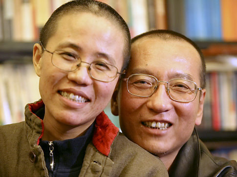 Chinese dissident Liu Xiaobo and his wife Liu Xia pose in this undated photo released by his family on October 3, 2010. Imprisoned Chinese pro-democracy activist Liu Xiaobo won the Nobel Peace Prize on October 8, 2010, an announcement that Beijing had anticipated and bitterly criticised.