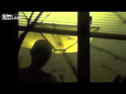Liu Xia smoking at her apartment window, Beijing, October 2012, video by Reporters Without Borders, screenshot.