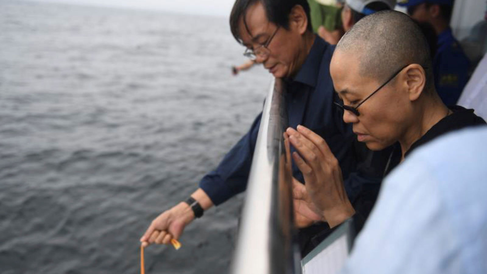 Liu Xia, wife of deceased Chinese Nobel Peace Prize-winning dissident Liu Xiaobo and other relatives attend his sea burial off the coast of Dalian, China in this photo released by Shenyang Municipal Information Office on July 15, 2017.