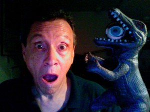 A. D. Coleman with dinosaur, self-portrait, 8-18-2011.