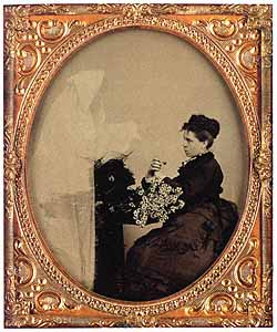 Unidentified Photographer (U.S.) Woman with Daisies and Spirit , Tintype, Sixth-plate,  circa 1875.