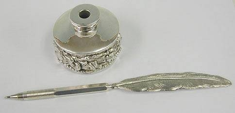 Sterling silver quill pen and inkwell set with jerusalem relief view.