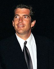 John F. Kennedy Jr. greets invited guests at the HBO and Imagine Entertainment premiere held at the Kennedy Space Center, 1998. (Photo credit NASA/KSC)