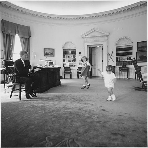 President John F. Kennedy, Caroline Kennedy, John F. Kennedy , Jr., White House, Oval Office, October 10, 1962. Photocraph by Cecil Stoughton. Courtesy National Archives and Records Administration.