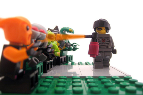 Pepper-spray cop with legos. Anonymous still life.