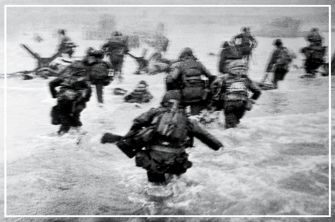 Capa detail: CS frame 1, neg. 29 - Robert Capa at Omaha Beach on D-Day, 6 June 1944.