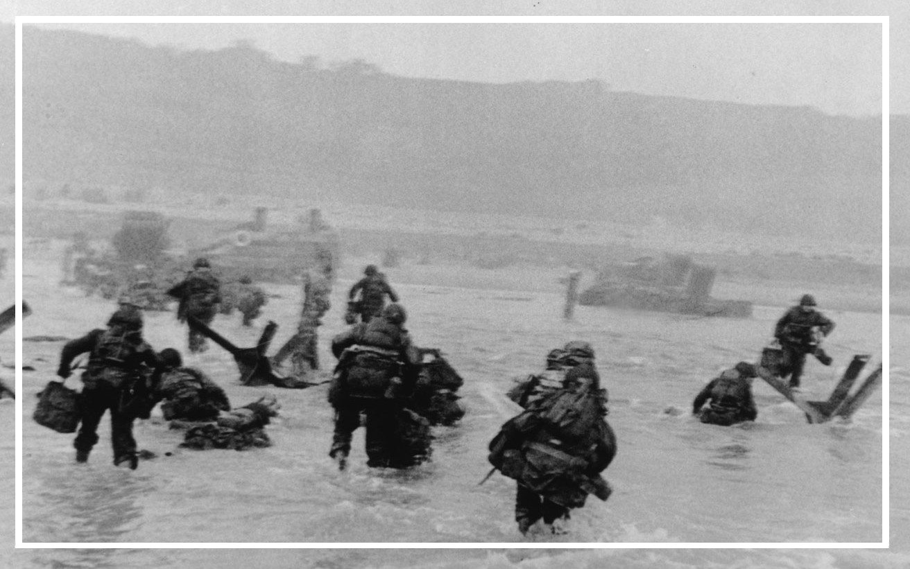 Capa detail: CS frame 2, neg. 30 - Robert Capa at Omaha Beach on D-Day, 6 June 1944.