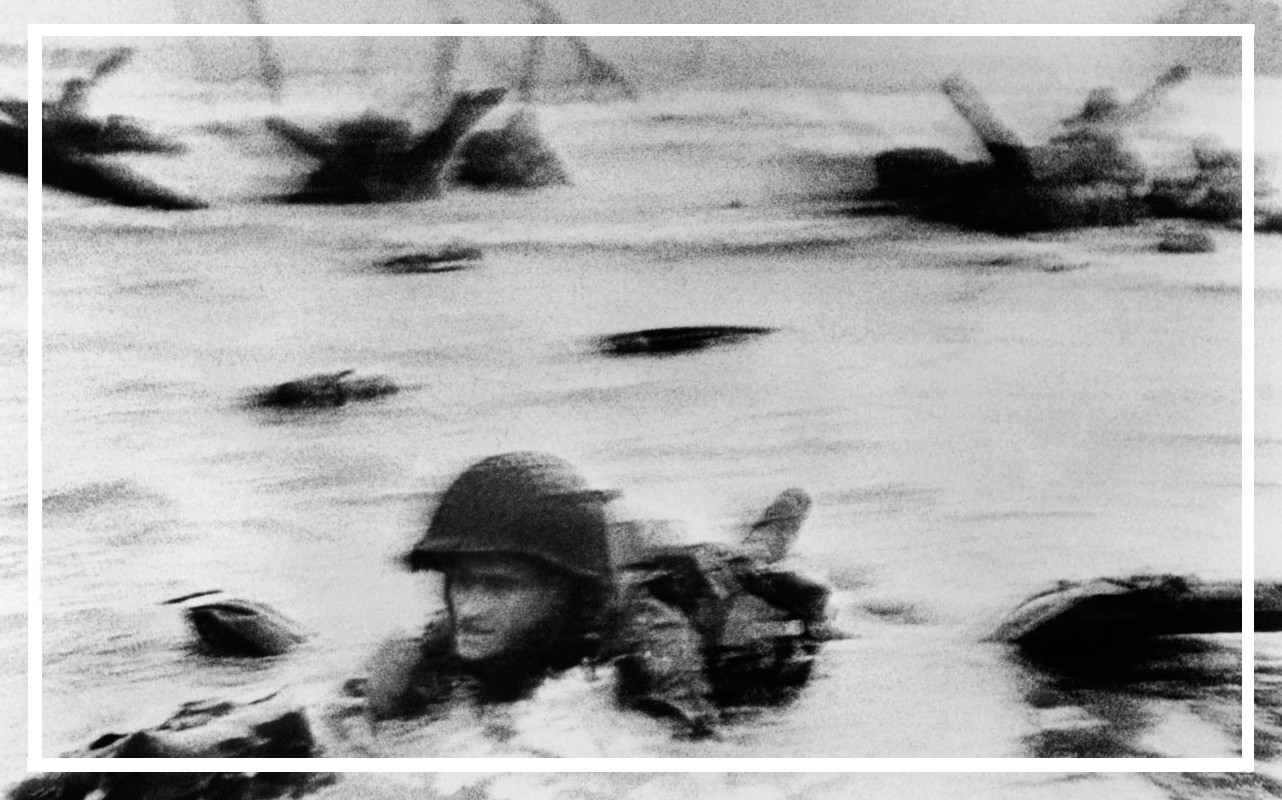 Capa detail: CS frame 9, neg. 37 – Robert Capa at Omaha Beach on D-Day, 6 June 1944.