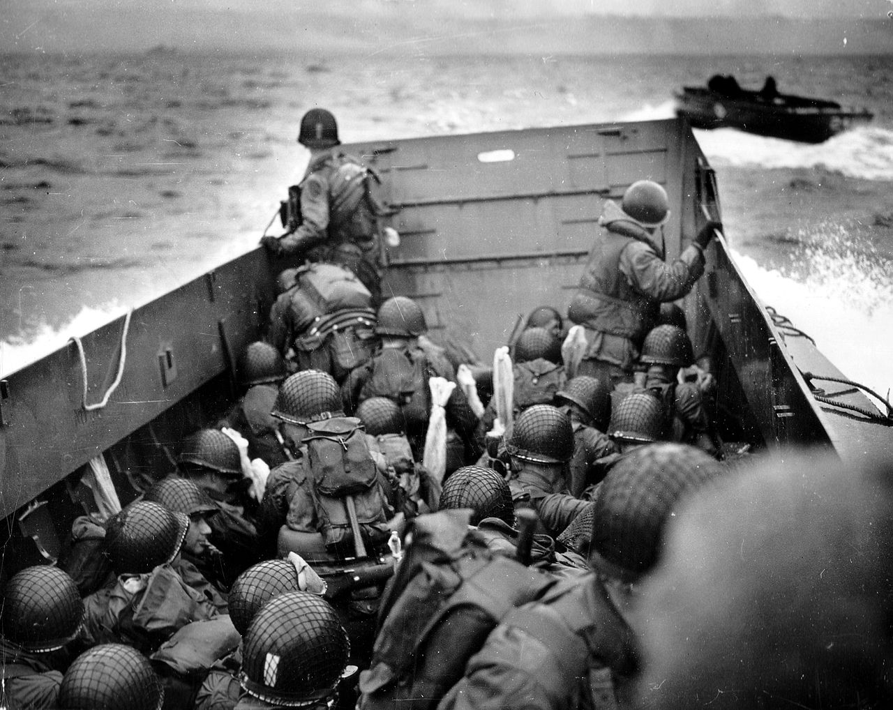 An officer observes Omaha as his landing craft approaches the Norman coast. Photo courtesy U.S. National Archives.
