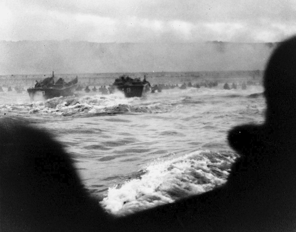 "Robert Sargent, US Coast Guard First Photographers Mate, ""Landing craft put troops ashore on Omaha Beach,"" first wave, 6-6-44. Courtesy National Archives."