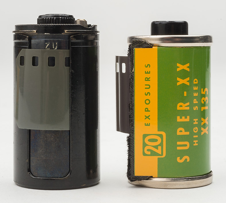A Zeiss Ikon reloadable cassette is shown next to Kodak's slightly shorter prepackaged cassette. Photo © 2015 by Rob McElroy.