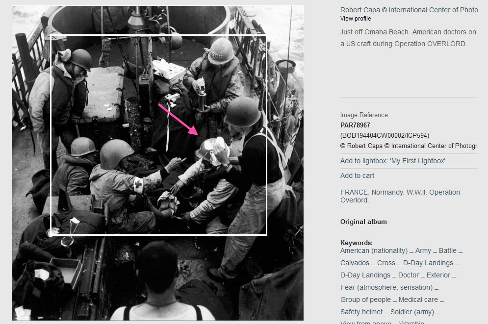 "Robert Capa, ""Untitled (Medics at Omaha Beach, June 6, 1944)."" Annotated screenshot from magnumphotos.com. Victor Haboush indicated by red arrow."