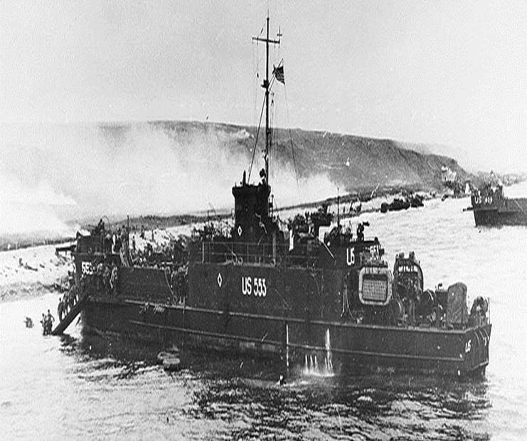 Figure 9. LCI(L) - Landing Craft, Infantry (Large), the type of craft on which Capa made his departure from Easy Red. With a capacity of about 186 troops, it was the largest beaching craft used at Omaha on D-Day. The LCI(L)-553 is shown beaching on Easy Red west of the ruins. It discharged its troops without incident. Unfortunately, it was stuck on the beach, and repeated efforts to free it failed. The crew eventually abandoned ship. It was only later that German fire was able to finally hit the abandoned ship and start a fatal fire.
