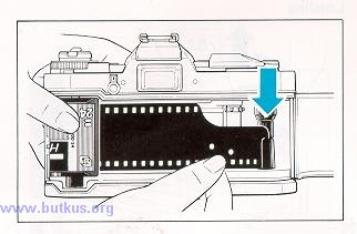 Fig. 2. Loading 35mm film in canister, using leader.