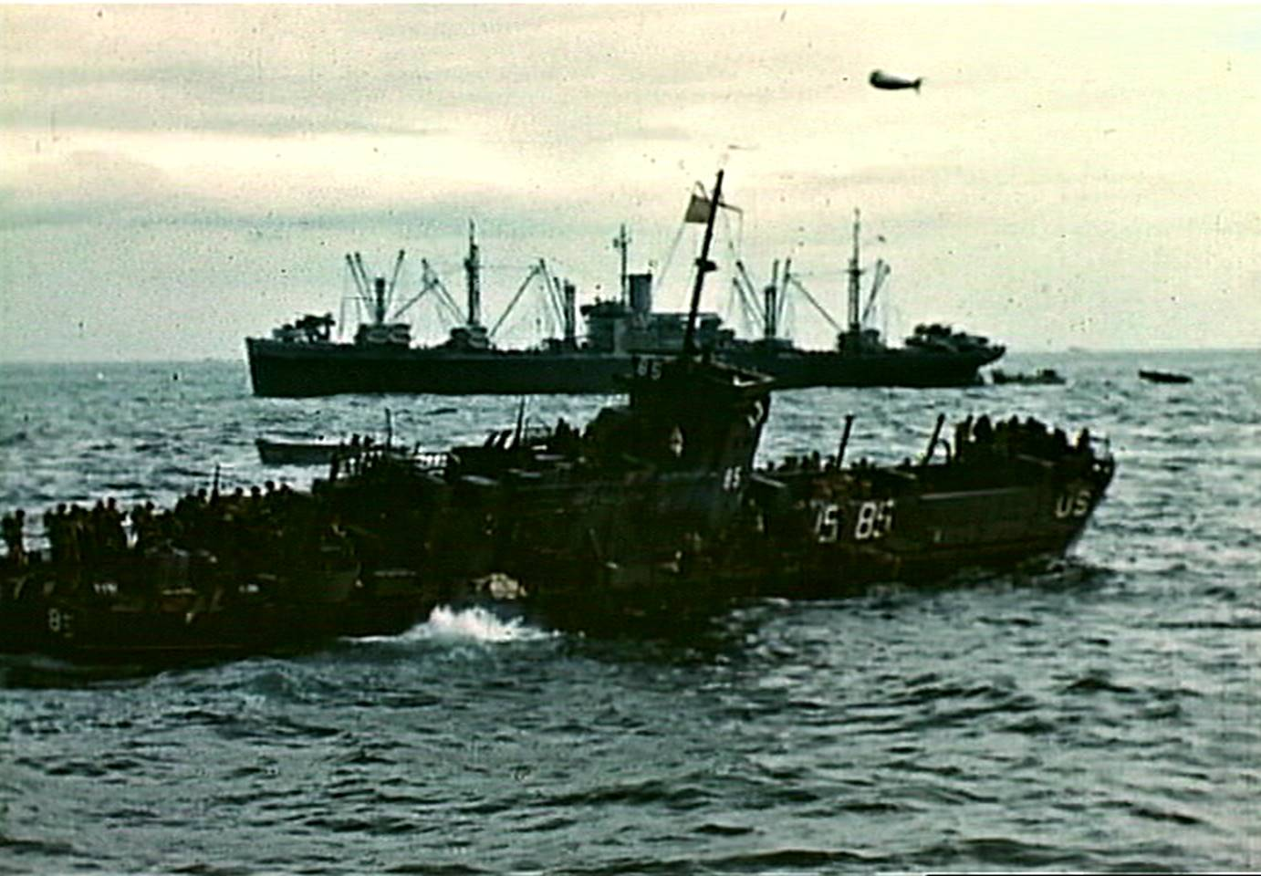Fig. 15: Fatally damaged LCI(L)-85 returns to USS Samuel Chase, D-Day, frame from film by David T. Ruley