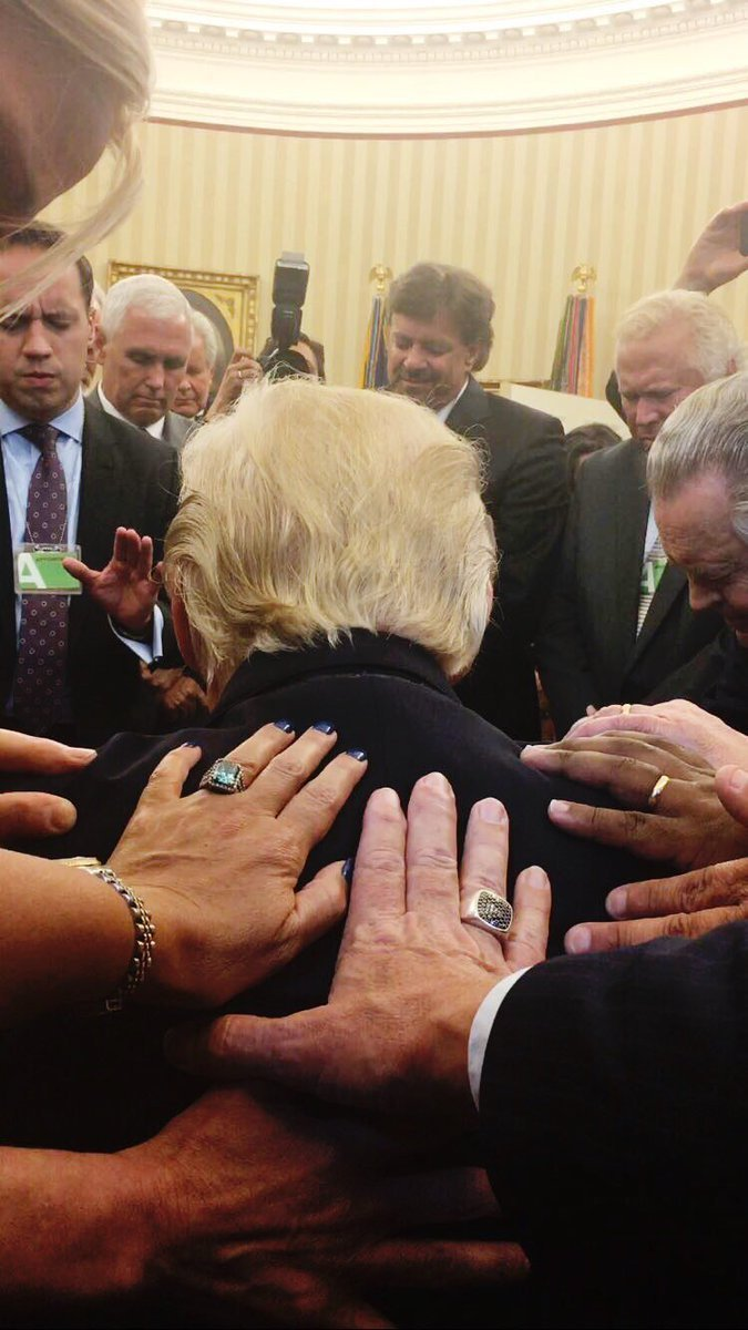 Donald Trump, Mike Pence, Michele Bachman praying with evangelicals in the Oval Office, July 10, 2017. Photo by Johnnie Moore.