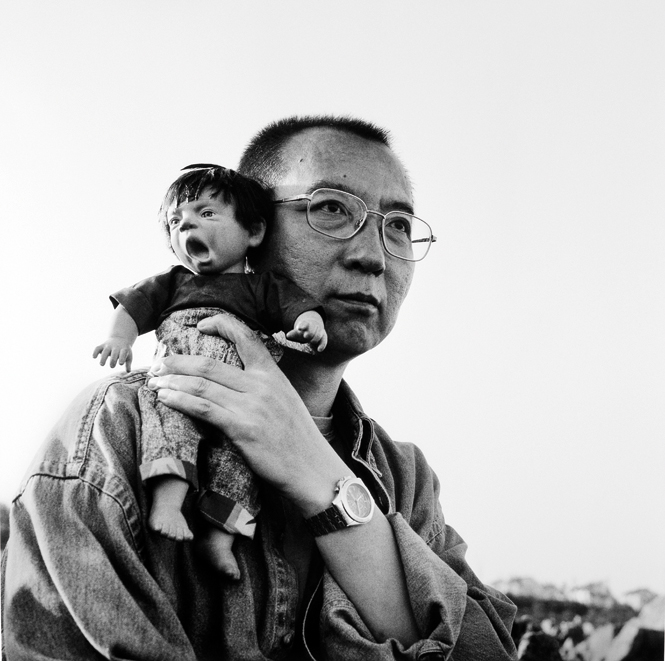 "Untitled photograph (Liu Xiaobo with doll), ca. 1999, © copyright by Liu Xia, from the ""Ugly Babies"" series"