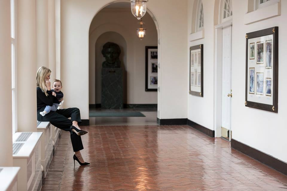 Holding her youngest son Theodore, Ivanka Trump talks on the phone in the East Colonnade of the White House, Sunday, Jan. 29, 2017. (Official White House Photo by Shealah Craighead)
