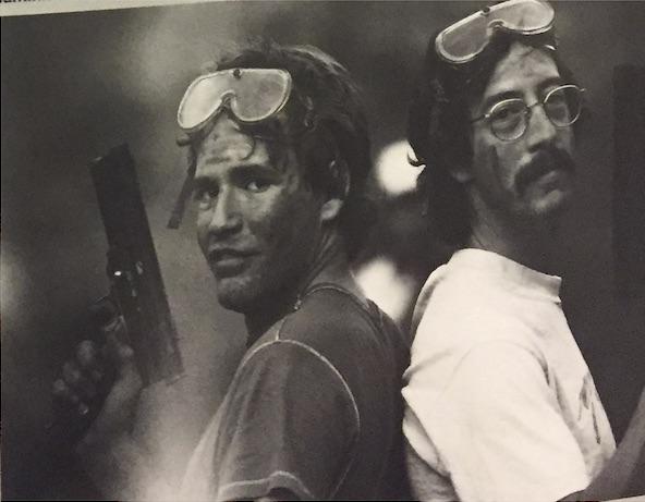 Triggermen: David Cohen (l), Rick Smolan (r). at an unidentified paintball park. Photographer unknown.