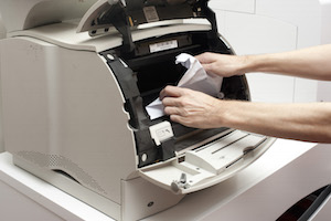 Freeing a paper jam in an office printer